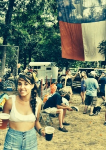 Here I am in Austin, TX at Eeyore's Birthday. Two beers in hand, a Texas flag, and sweaty as hell!
