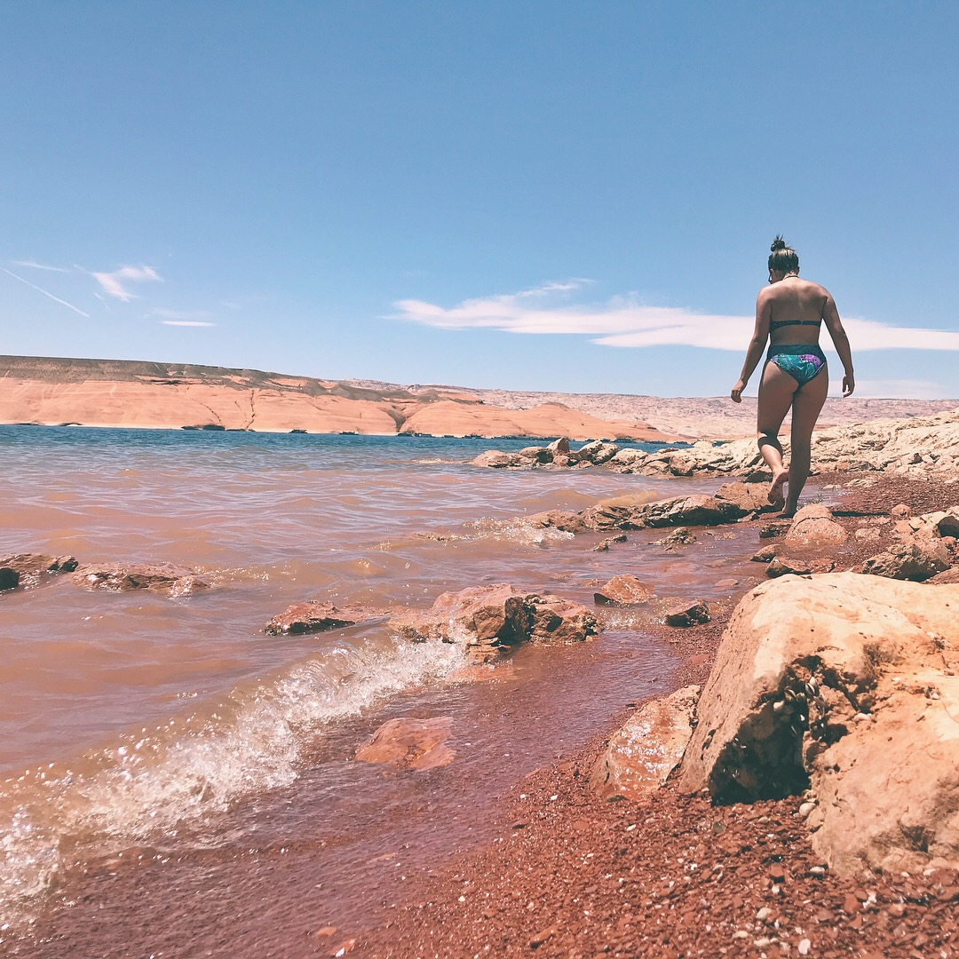 walking on the beach in lake powell